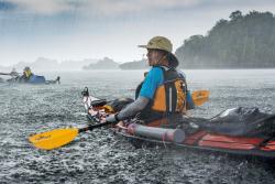 Kayaking in rain, Raja Ampat, Indonesia